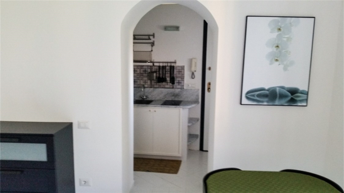 Dining area with archway to the kitchen